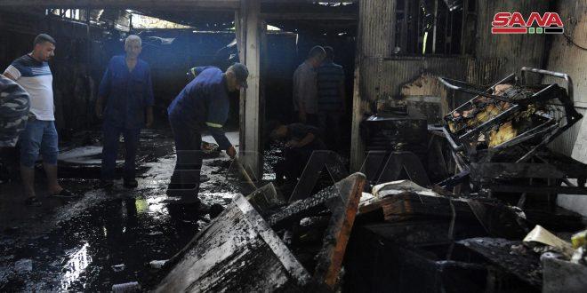 إخماد حريق ضمن محل لتنجيد وغسيل السيارات في كفرسوسة